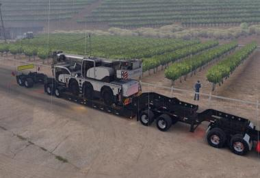Long Oversized Trailer Magnitude 55l with a Load Offroad Crane